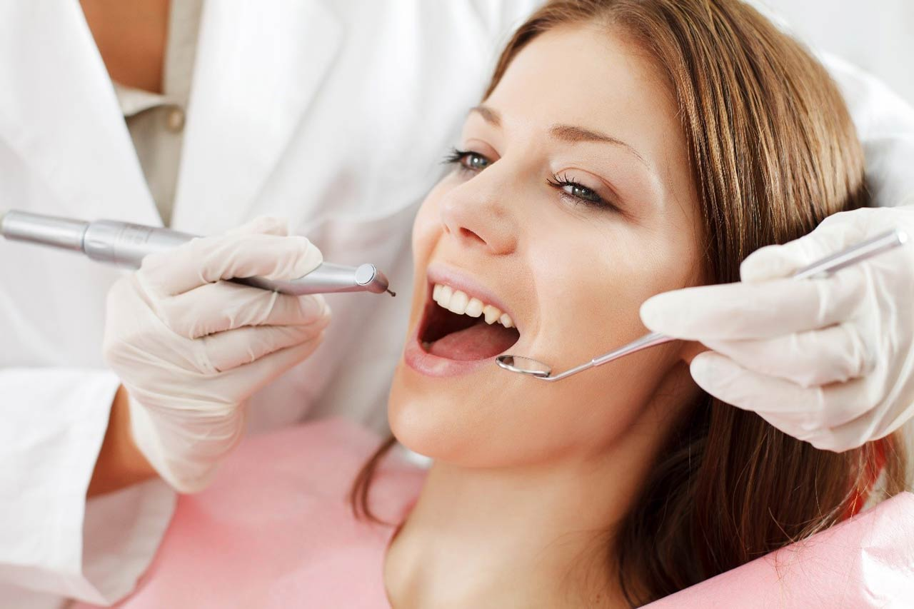 girl getting dental treatment